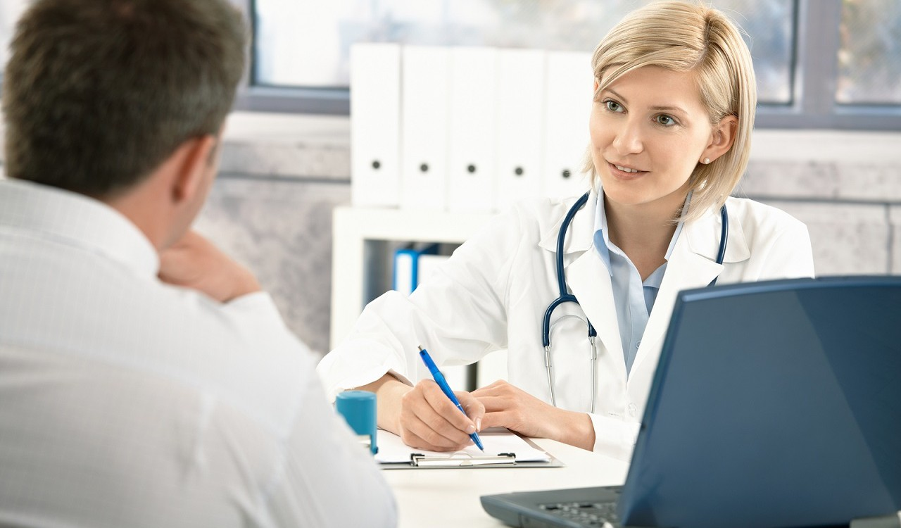 bigstock-Doctor-talking-to-patient-in-o-17657432-1280x750
